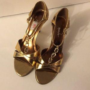 Gold, formalwear Jacqueline Ferrar shoes.